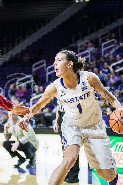 Senior forward Kaylee Page scans the court for an open teammate against Texas Tech in Bramlage Coliseum on Feb. 7, 2018. The Wildcats defeated Red Raiders with a final score of 83-69. (Logan Wassall | Collegian Media Group)