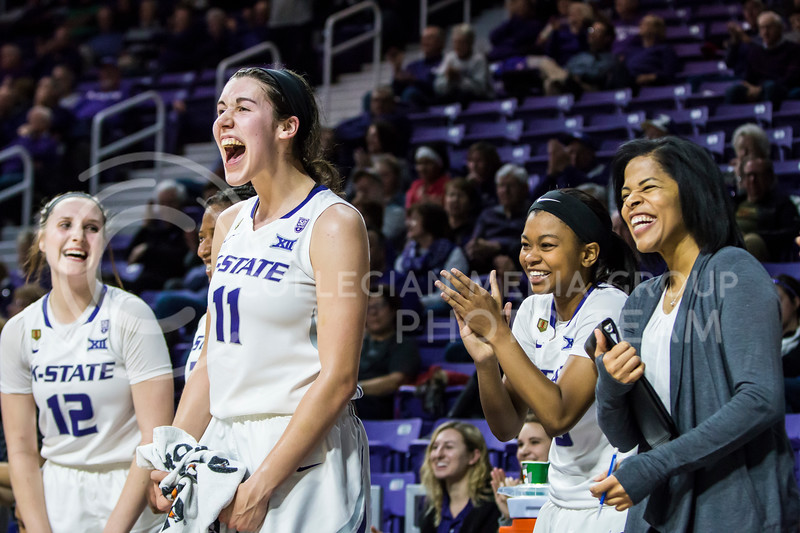 The women's basketball team cheers on their teammate from the bench as a fouled shot is made in Bramlage Coliseum on Wednesday. The Wildcats defeated the Texas Tech Red Raiders 83-69. (Logan Wassall | Collegian Media Group)