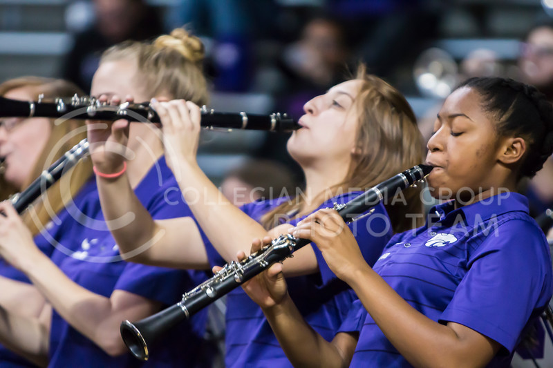 With great energy, the K-State pep band plays at the womens basketball game against Texas Tech in Bramlage Coliseum on Feb. 7, 2018. The Wildcats defeated Red Raiders with a final score of 83-69. (Logan Wassall | Collegian Media Group)