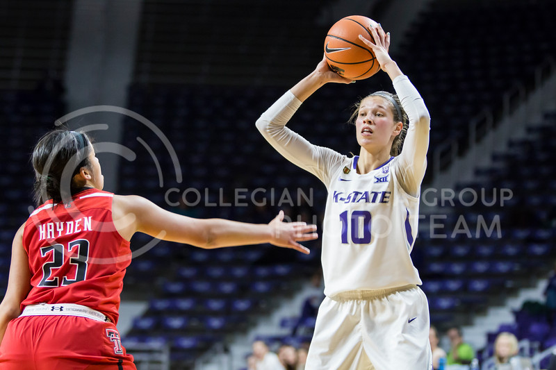 Junior Guard Kayla Goth scans the court for an open teammate against Texas Tech in Bramlage Coliseum on Feb. 7, 2018. The Wildcats defeated Red Raiders with a final score of 83-69. (Logan Wassall | Collegian Media Group)
