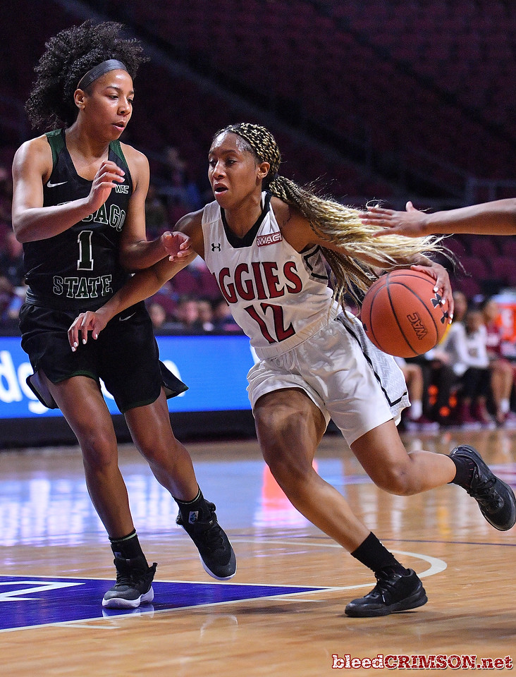 LAS VEGAS, NV - MARCH 07:  Zaire Williams #12 of the New Mexico State Aggies drives against Phylicia Johnson #1 of the Chicago State Cougars during a quarterfinal game of the Western Athletic Conference basketball tournament at the Orleans Arena in Las Vegas, Nevada. The Aggies won 84-60.