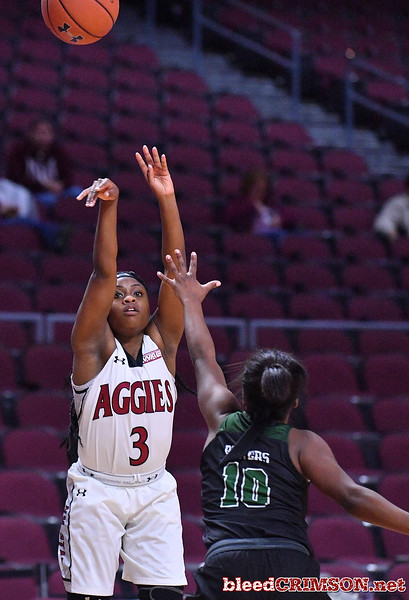 LAS VEGAS, NV - MARCH 07:  Tonishia Childress #3 of the New Mexico State Aggies shoots against Tyeshia Bowers #10 of the Chicago State Cougars during a quarterfinal game of the Western Athletic Conference basketball tournament at the Orleans Arena in Las Vegas, Nevada. The Aggies won 84-60.