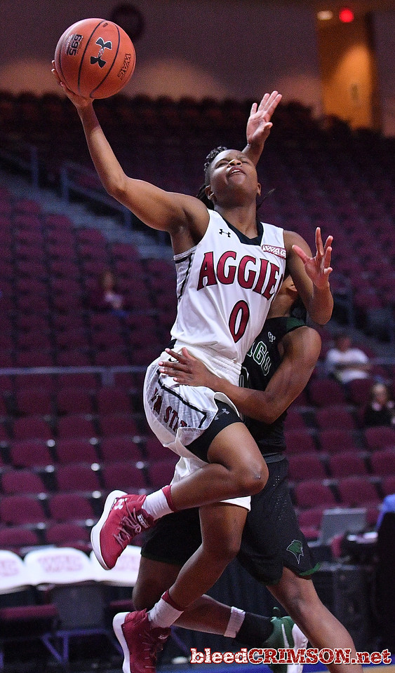 LAS VEGAS, NV - MARCH 07:  Pam Wilmore #0 of the New Mexico State Aggies is fouled by Tyeshia Bowers #10 of the Chicago State Cougars during a quarterfinal game of the Western Athletic Conference basketball tournament at the Orleans Arena in Las Vegas, Nevada. The Aggies won 84-60.