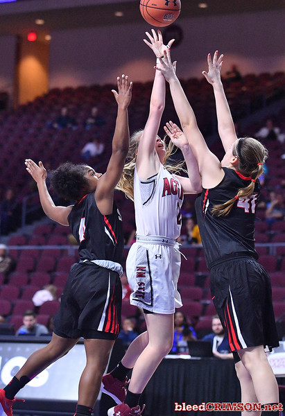 LAS VEGAS, NV - MARCH 09:  Brooke Salas #2 of the New Mexico State Aggies] shoots against Kallin Spiller #41 of the Seattle Redhawks during a semifinal game of the Western Athletic Conference basketball tournament at the Orleans Arena in Las Vegas, Nevada. Seattle won 84-61.