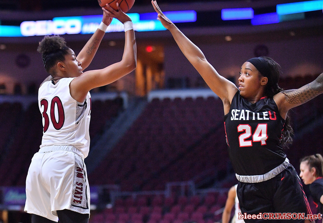 LAS VEGAS, NV - MARCH 09:  Gia Pack #30 of the New Mexico State Aggies shoots against Alexis Montgomery #24 of the Seattle Redhawks during a semifinal game of the Western Athletic Conference basketball tournament at the Orleans Arena in Las Vegas, Nevada. Seattle won 84-61.