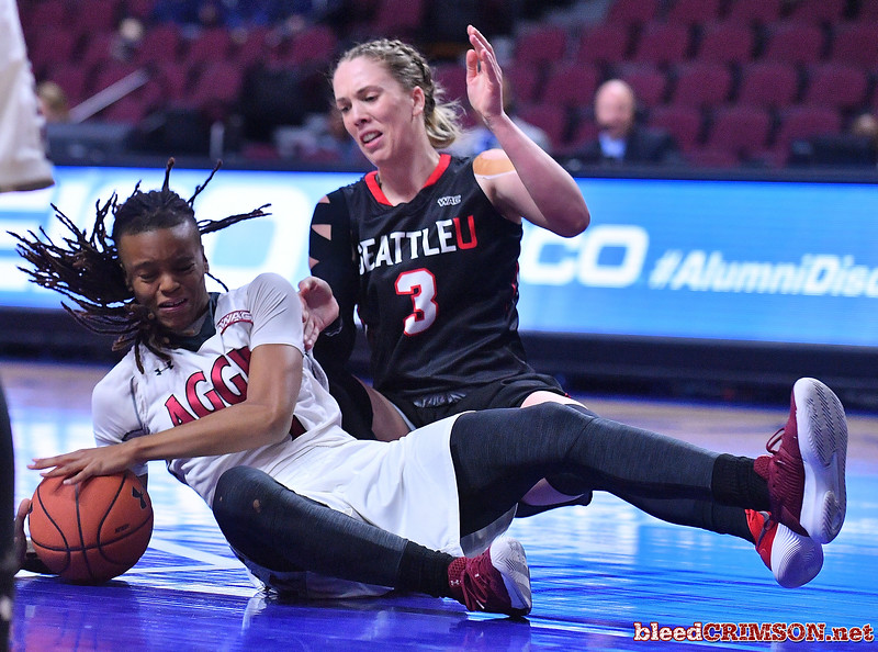 LAS VEGAS, NV - MARCH 09:  Jasmine Cooper #1 of the New Mexico State Aggies battles Jacinta Beckley #3 of the Seattle Redhawks for a look ball during a semifinal game of the Western Athletic Conference basketball tournament at the Orleans Arena in Las Vegas, Nevada. Seattle won 84-61.