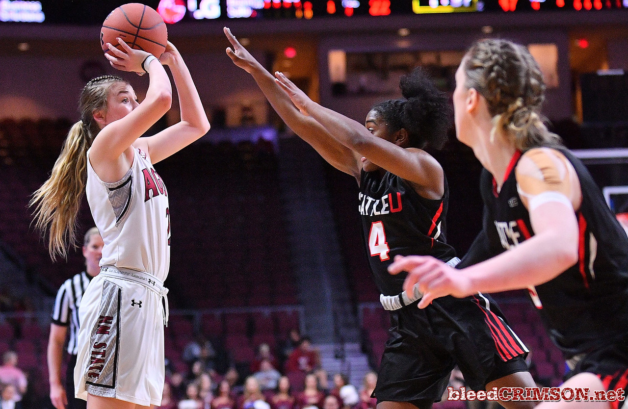 LAS VEGAS, NV - MARCH 09:  Brooke Salas #2 of the New Mexico State Aggies shoots against McKenzi Williams #4 of the Seattle Redhawks during a semifinal game of the Western Athletic Conference basketball tournament at the Orleans Arena in Las Vegas, Nevada. Seattle won 84-61.