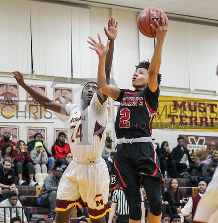 January 21, 2020: WCAC boys basketball action between St Johns and Bishop McNamara .  Photos by Chris Thompkins/thesportsfannetwork