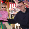 MK - Madison and Daddy riding carousel 2 12-7-03