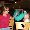 Chef Mickey's - Mommy and Madison napkin twirling 12-2-04
