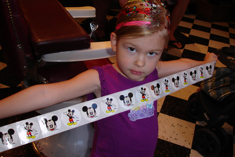 MK - Madison gets a lot of stickers at the barbershop 12-10-05