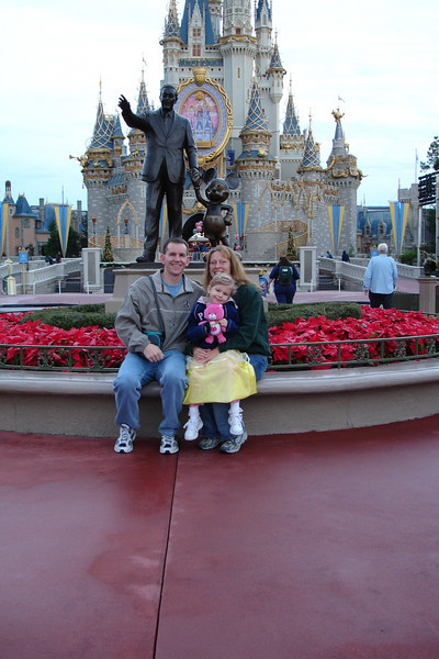 MK - Vail Family in front of Walt and Mickey statue 2 12-11-05