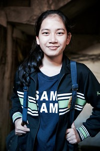 """Davry, 18, Phnom Penh.  """"I love teaching kids. I want to listen to them, help them and motivate them!""""  Davry has a remarkable outlook on life for an 18 year old and growing up in a slum area in Phnom Penh has lead to her ultimate goal of helping the poor. Although she's had her fair share of challenges, what shines through is Davry's underlying determination.   """"I would look at other kids and wonder why they had a mother and I didn't""""  Davry grew up in a small farming village in northern Cambodia. Her parents separated when she was 4 years old, effectively abandoning her, but thankfully a great-aunt in Phnom Penh took her in. These years were very tough for Davry:  """"I had no one to turn to, as my aunty was busy working. I didn't know where my mother was and my father moved to Thailand for work. On top of this, I had to sell food in order to earn the 25 cents I needed to pay for school.""""  """"My NGO has made me stronger""""  Davry's life changed when she started going to classes at a local NGO. Here she began to feel more empowered through lessons in leadership, teamwork, debating and English to name a few. This then inspired Davry, along with a few others, to start their own organisation called 'Smile Group'. Their aim was to help the local community by providing school materials for children, as well as educating them in hygiene, waste management, recycling and other various social issues.  """"I want to become a doctor and provide free healthcare for the poor""""  Davry's long term plans have meant she now places a lot of importance on her own education. She hit a hurdle at the end of last year however, as she didn't acquire the grades needed to get into university. This has meant repeating her final year of high school and for now, putting the Smile Group on hold. During my last conversation with Davry, she mentioned that one of her teachers had refused to let her sit an exam due to low attendance for a Saturday class, even though she explained that she has to work on weeke"""