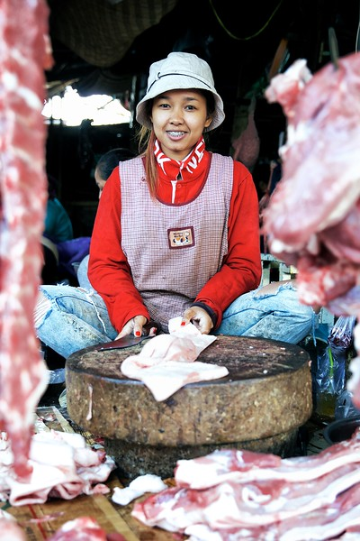 "Srey Neng, 27, Kandal Market, Phnom Penh.<br /> <br /> ""I like my job - it put me through university.""<br /> <br /> Srey Neng has worked in her parents' butchery for the last 7 years. During this time, she has also managed to complete an accounting degree, as well as learning Vietnamese to converse with Vietnamese customers. .<br /> ""I would like to work in accounting, but at the moment my parents need me to help out in the shop.""<br /> <br /> 2016."