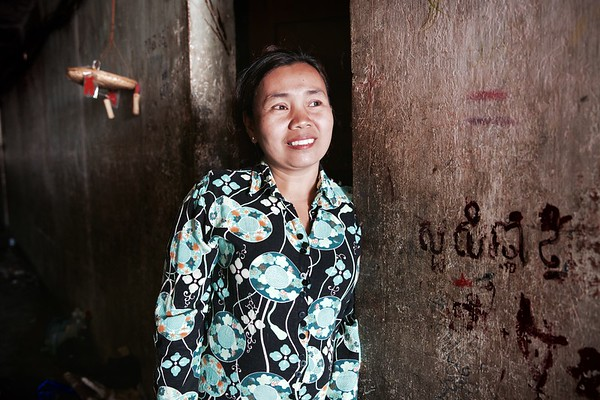 """Ny, Phnom Penh. """"Life is normal here - I know everyone""""  Ny's family have lived on the top floor of the White Building since 1982. She says she's happy living here and has one of her five children living in the next apartment.  2016."""