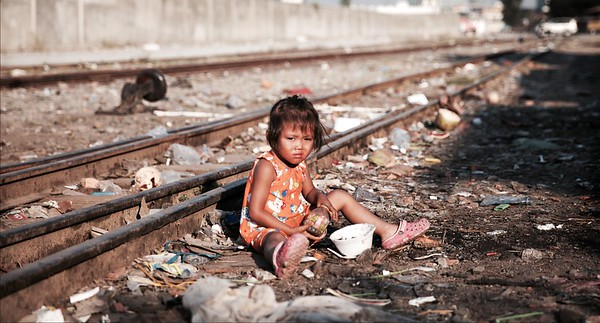 A little girl's playground -  Railway Slums, Phnom Penh.  Phnom Penh is a city of both incredible beauty and unbelievable hardship. This first photo for me, personifies this beauty and heartache. Thanks for taking the time to voyage with me: WE - ARE CAMBODIA.  2016.