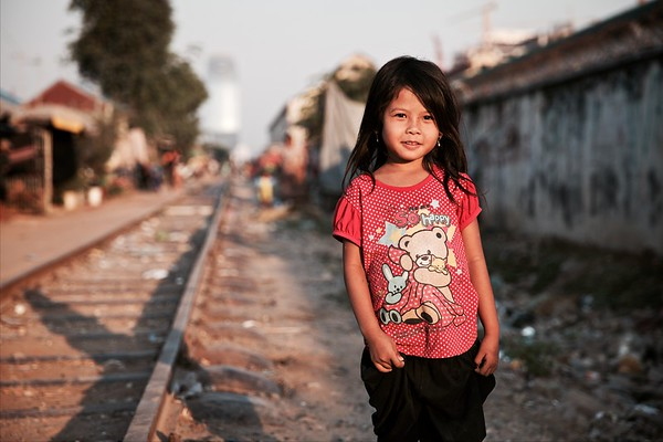 After I took this photo I said to the girl that she looks pretty. She looked at me with an expression and smile on her face that said 'I know!'  Railway slums, Phnom Penh, 2016.