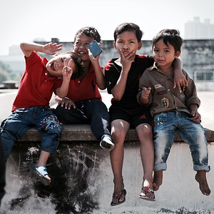 There's lots of laughter and chatter as children play on rooftops and in corridors - the White Building, Phnom Penh.  2016.