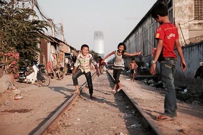 Playing marbles - Railway Slums, Phnom Penh.  2016.