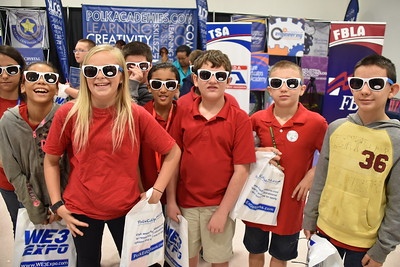 "Students fill up their ""swag bags"" with colorful Polk Academies shades."