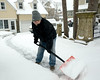 "German Reyes, originally from Florida, comments, ""This is crazy!"" as he shovels his long, up-hill driveway in Ambler Jan. 21, 2014."