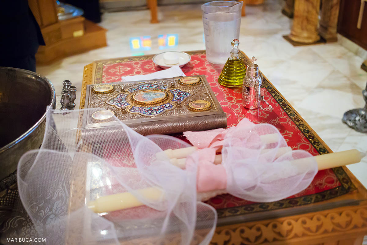 Bible and candles in SAN JOSE GREEK ORTHODOX BAPTISM
