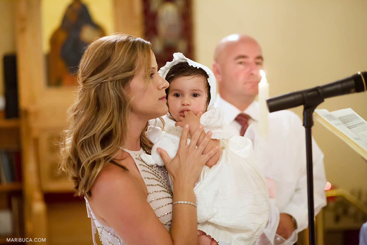 godmother during greek orthodox baptism