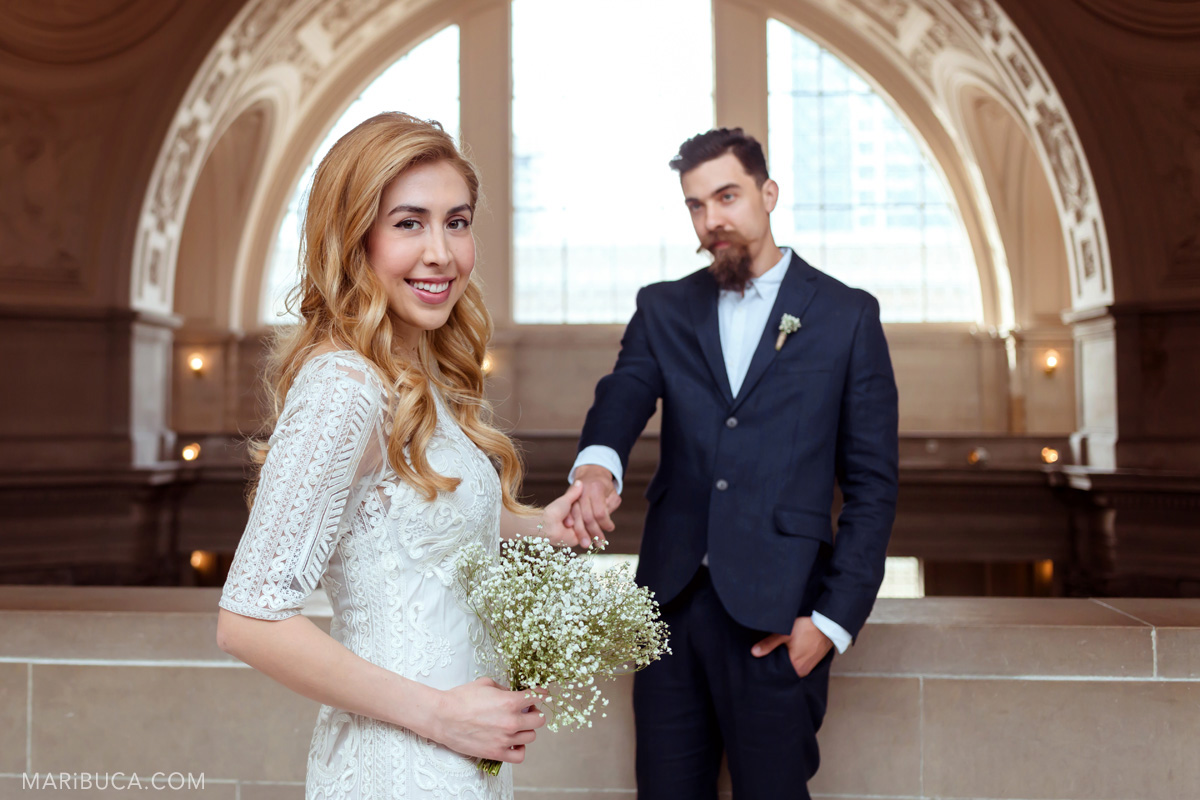 035-wedding-portrait-sf-city-hall-hold-hands