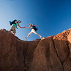 Couple on cliff face