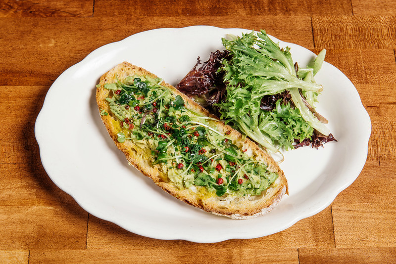 Roux, French bistro and wine bar, 688 Park Avenue, Rochester, NY 14607. In this photo, tartine with avocado and pink peppercorn spread. Photo by Brandon Vick Photography LLC, http://brandonvickphotography.com/