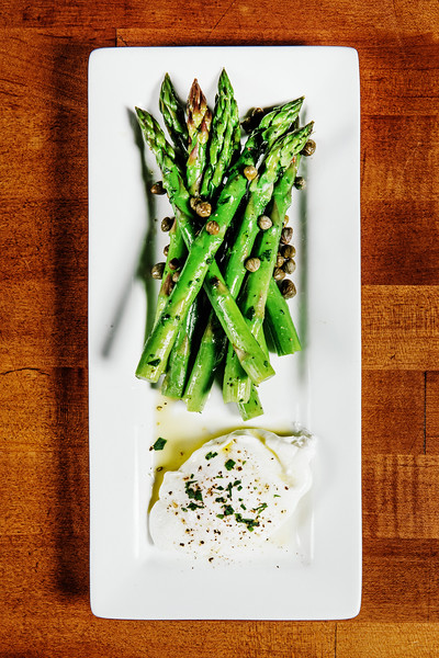 Roux, French bistro and wine bar, 688 Park Avenue, Rochester, NY 14607. In this photo, sautéed asparagus with capers and lemon served alongside a poached organic egg. Photo by Brandon Vick Photography LLC, http://brandonvickphotography.com/