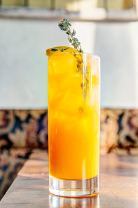 """Roux, French bistro and wine bar, 688 Park Avenue, Rochester, NY 14607. In this photo, """"The March Hare"""": Gin, genepy, ginger root, thyme, lemon, carrot juice, and soda.Photo by Brandon Vick Photography LLC, http://brandonvickphotography.com/"""