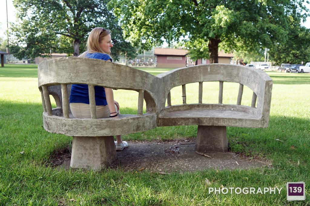 Photograph a park bench.