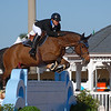 WEST PALM BEACH, FLORIDA - January 13, 2018: Teddy Vlock and Charly Brown competing to win the SJHOF A/O Classic at week 1 of the Winter Equestrian Festival in Wellington, Florida