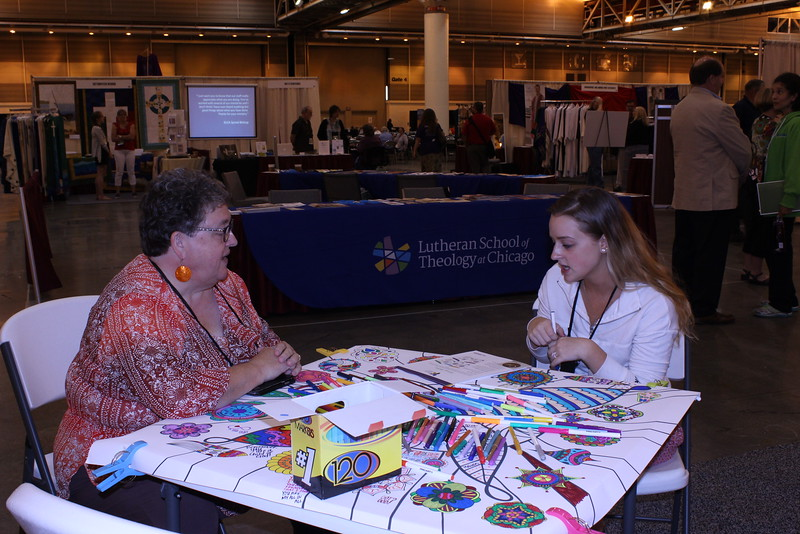 WELCA @ 2016 ELCA Churchwide Assembly and Grace Gathering<br /> <br /> Inviting visitors to color in our space gave staff, like Women of the ELCA's executive director, opportunities to meet with women of all ages and share about the organization.