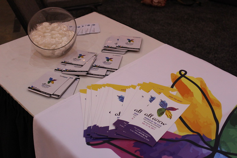 WELCA @ 2016 ELCA Churchwide Assembly and Grace Gathering<br /> <br /> Our table with promotional items like pins, picture magnets, temporary tattoos, and Save the Date cards were very popular. Don't miss the Tenth Triennial Gathering happening July 2017 in Minneapolis!