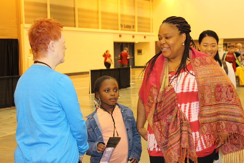 WELCA @ 2016 ELCA Churchwide Assembly and Grace Gathering<br /> <br /> Patti Austin, Left, talks with Leymah Gbowee, pictured far right, and her daughter at our exhibit booth.
