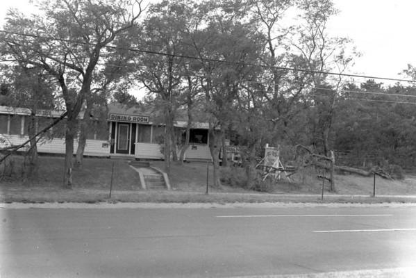 Hurricane damage at Bill and Vics, Rte 6, Wellfleet, MA , late 1950s