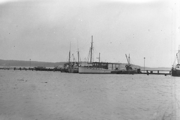 Hurricane - boats huddled inside the harbor, Wellfleet, MA , late 1950s