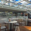 The sunny and inviting Aquavit Terrace offers great views at the bow of the ship on the upper deck.