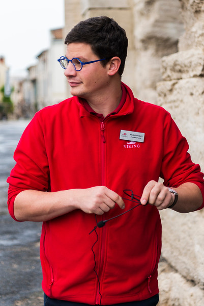 Program Director Nickolas assists a tour guide at Arles.