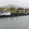 A coal barge slides by our vessel south of Valence.
