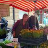 Selling flowers.