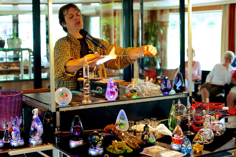 A local glass blowing expert gives a demonstration on the ship.