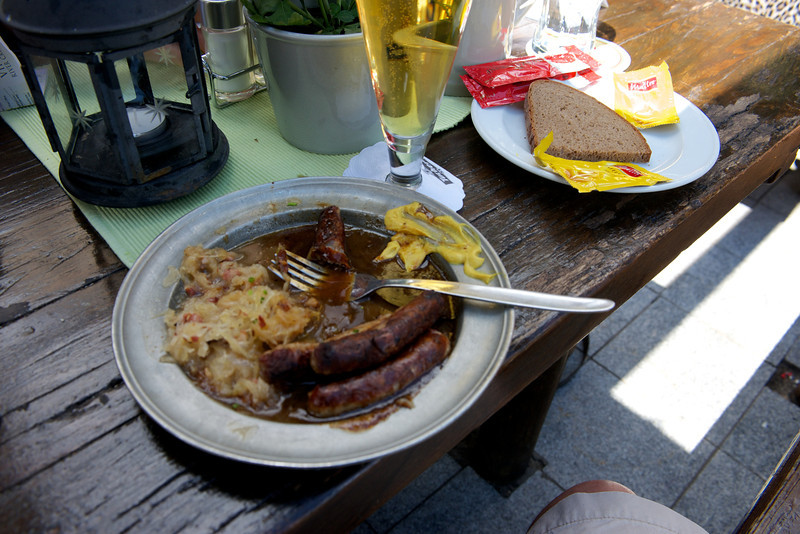 Traditional lunch of sauerkraut, Nuremberg sausage with mustard and beer.