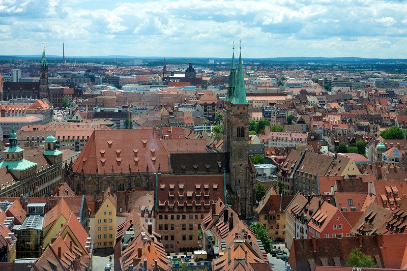 View of Nuremberg from the Imperial Castle with the spires of Saint Lorenz in the foreground and St. Sebaldus on the left at the horizon. On the left, middle, are the domes of the Rathaus (city hall).