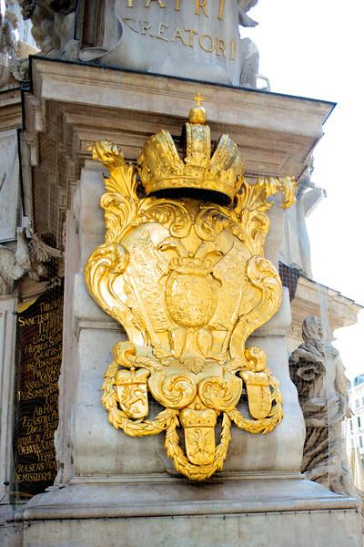 Detail of gold leaf plaque on the base of The Baroque Pestsäule.
