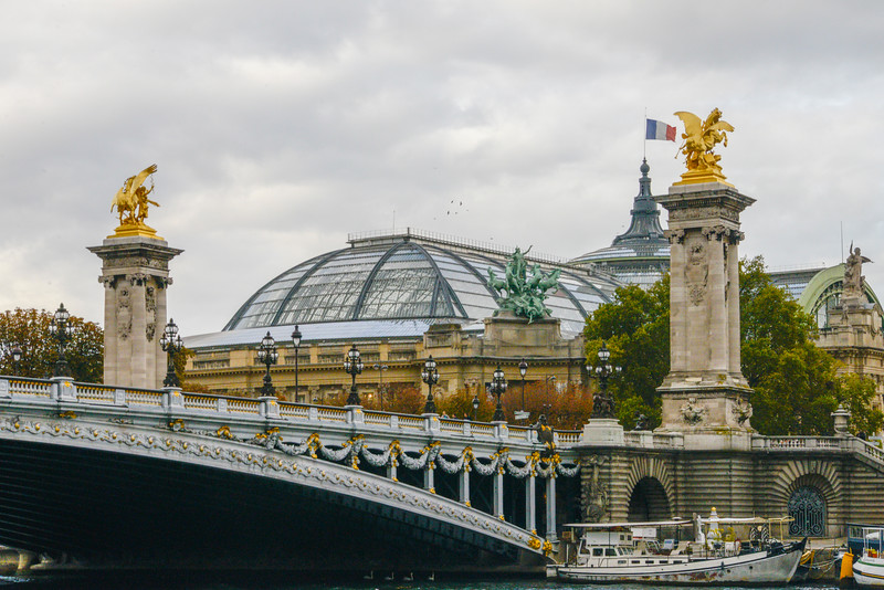 Pont Alexandre III  over the Seine.  Ornate, late 19th-century arched bridge in a Beaux Arts style & named after the Russian czar.  Behind, the Musee Air France.