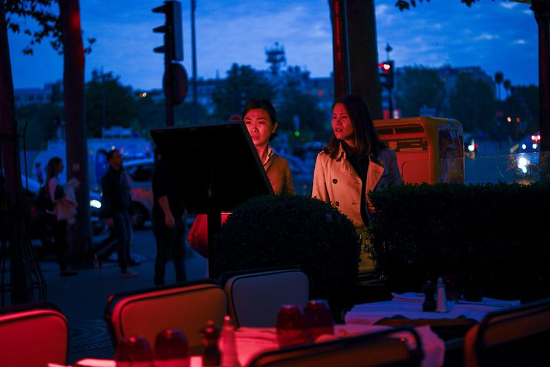 Diners inspect the menu at an outdoor café.