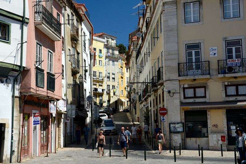 The streets of Portugal's largest city, Lisbon, in the Alfama neighborhood.  The remainder of Lisbon was generally rebuilt after the earthquake of 1755 but Alfama retains its narrow, twisted streets and alleys.